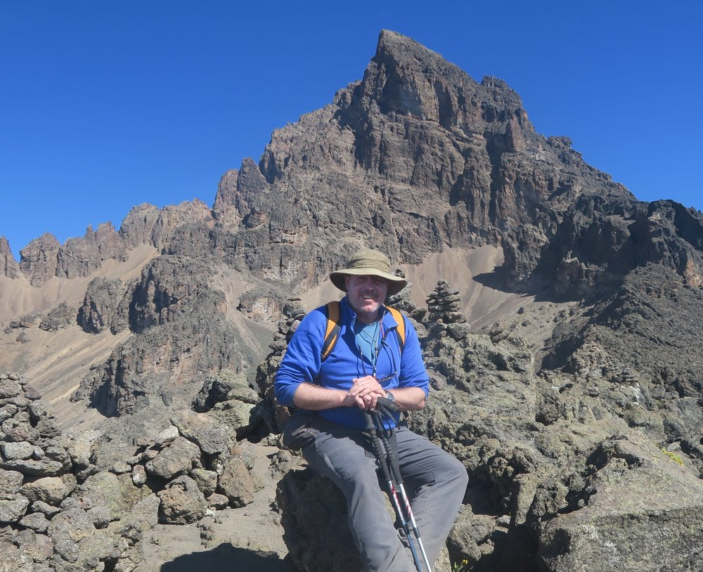 Fr. Mullen on an acclimatization hike on the slopes of Kilimanjaro, July 2016