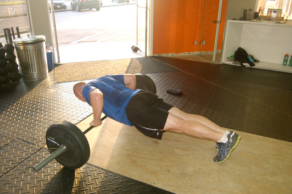 Chris F with some awesome barbell pushups!