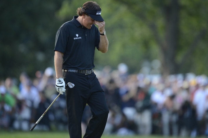 Phil Mickelson reacts as he comes up short on the 72nd hole, tieing for second for the sixth time in a US Open.