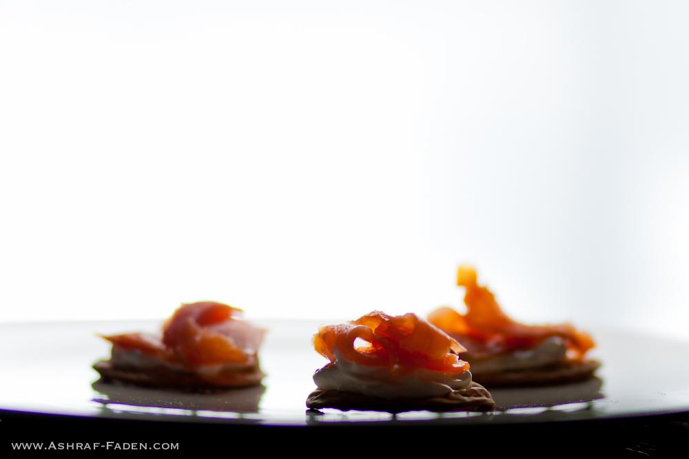 Smoked salmon on crackers and cream cheese.