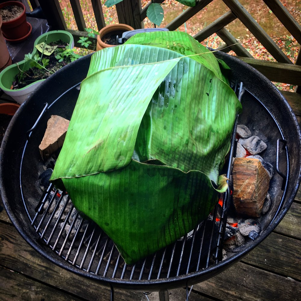 Turkey covered in banana leaves!