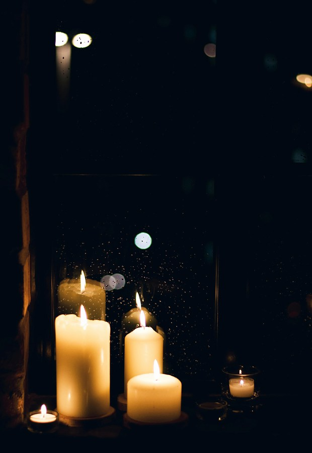 We were surrounded by beautiful candlelight  |  Photo by Abi Dare of These Four Walls