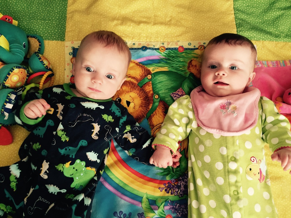 twincorporated babies holding hands.jpg