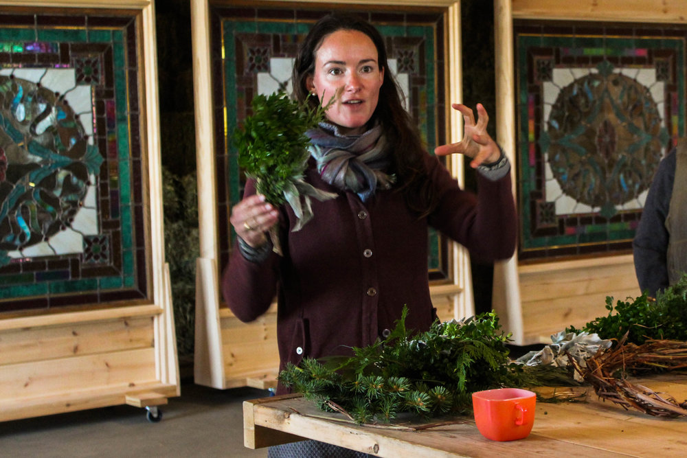 Phoebe demonstrates how to make a small bouquet with floral wire to layer on the wreath