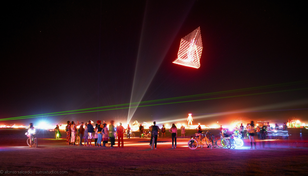 A group of participants from the FAFA camp fly out their custom-built LED pyramid drone in the middle of the Playa.