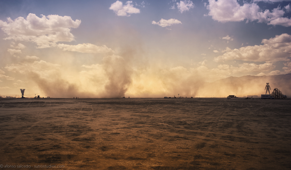 A series of dust devils takes place and moves around the Playa during pre-event construction of the Man.