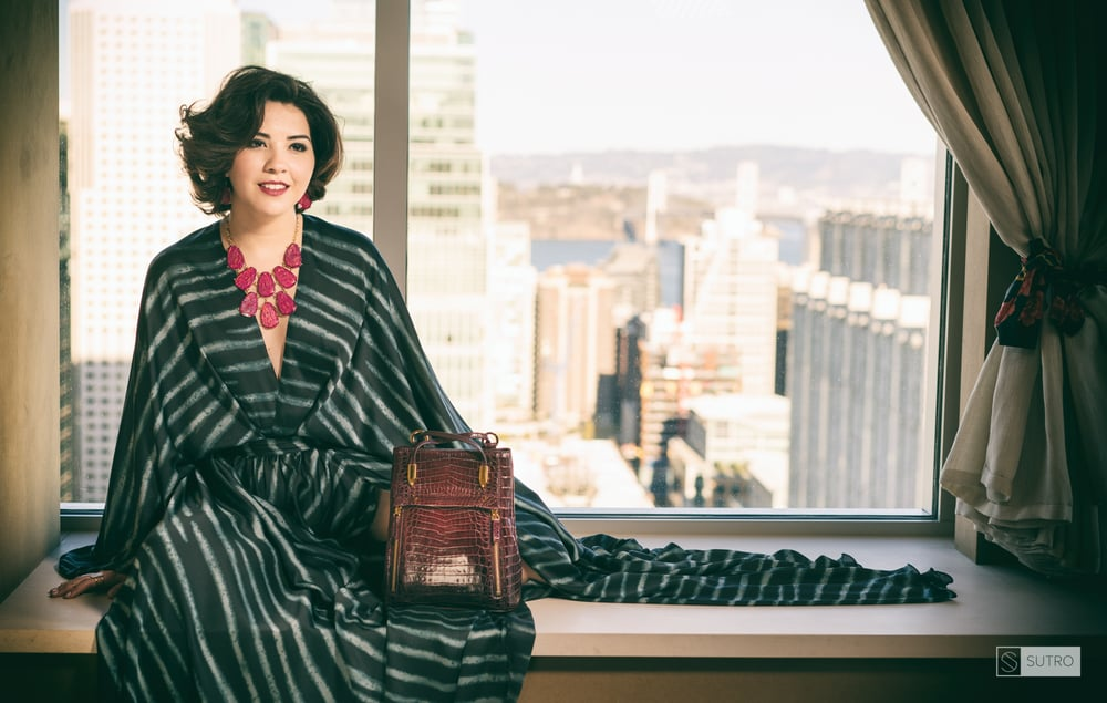 Melissa San Vicente with House of Borel handbag, at St. Regis San Francisco. Photographed by Afonso Salcedo. Hair and makeup by David Reposar.