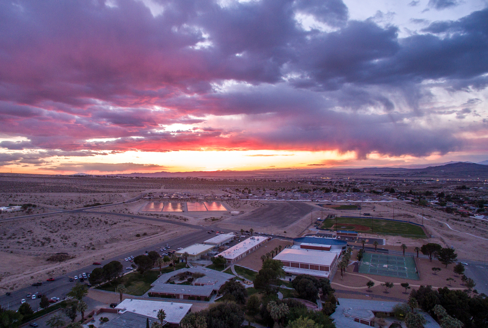 An aerial view of the campus and the sunset reflecting on the solar array. Filmed and capture by our Inspire 1 drone.
