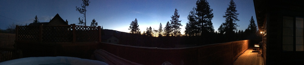 Panoramic shot from the hot tub of the surrounding treeline and wraparound deck.