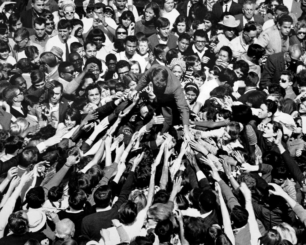 Bobby is swarmed by ecstatic supporters  during his tumultuous 1968 presidential race.