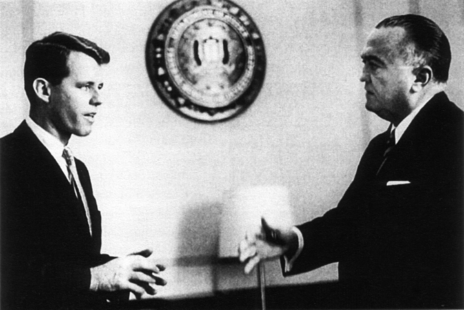 "Bobby warily eyes FBI chief J. Edgar Hoover  during a meeting at the bureau. The attorney general came to view Hoover as a ""menace to democracy,"" whose poisonous power over politicians came from his voluminous secret files.   Photo by   Jacques Lowe"