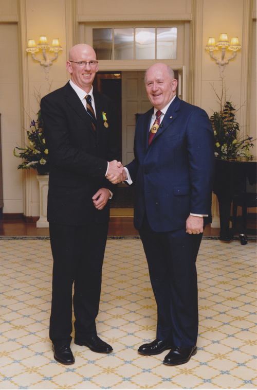 Marcellin Old Collegian (84) Dr Anthony McLeod receiving his Public Service medal from the Governor General, Sir Peter Cosgrove.