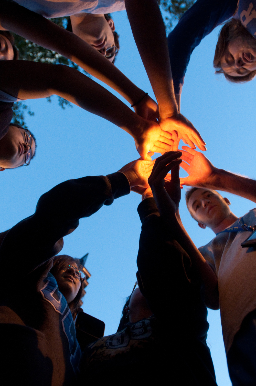 LOS ANGELES, CA – Students gather around a candle and share a moment in remembrance of John Wooden outside Ronald Reagan UCLA Medical Center on Friday, June 4, 2010.