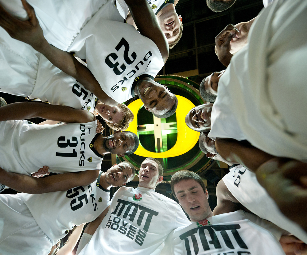 EUGENE, OR – The Oregon Ducks gather in the center of the Matthew Knight Arena court for a post game celebration huddle following their 75-68 victory over the Bruins on Saturday, January 21, 2012.