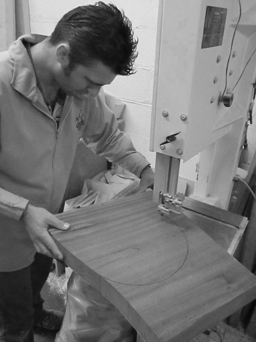 cutting the wood into rounds for turning