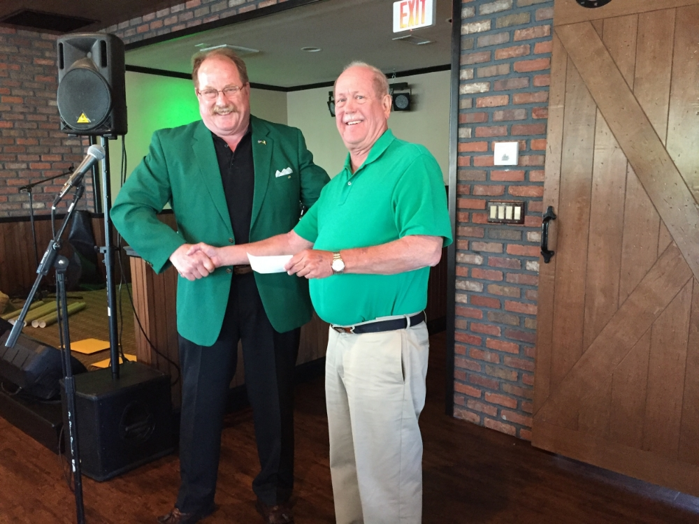 Jim Gaston handing over a $500 check from the FSSP to the Ivins Outreach Center in support of their golf outing fundraiser.