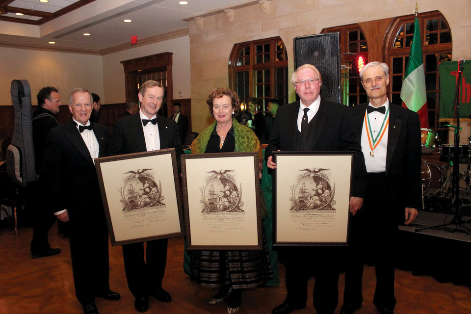 Friendly Sons President Joseph P. Heenan and Friendly Sons Secretary Russell W. Wylie (pictured at far right) present Honorary Society Membership Scrolls to: Taoiseach Enda Kenny; Consul General Barbara Jones; Guest of Honor Craig L. Adams, PECO President & CEO