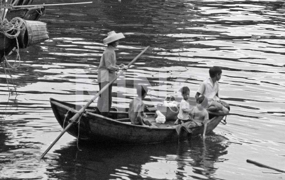 Family on boat B&W.jpg