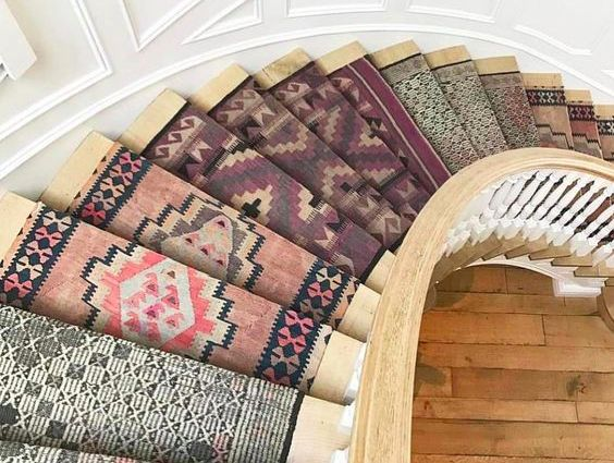 Design by Studio LifeStyle   If you are wanting to give your home a bohemian or a vintage flair, patchwork stair runners are one of the best and most efficient ways to do so. Stairs are often one of the first things seen in your home and patchwork runners are a great way to set the the tone for your interior style.  As you can see, they are universal enough to work well with dark and light interiors. Minimal surrounding decor is needed when such a strong design element in incorporated into your home. The key to patchwork stair runners is to find patterns and colors that compliment one another and the surrounding interior aesthetic.