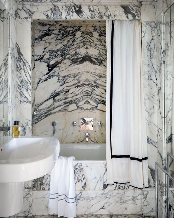 Book-matched stone shower  Source unknown