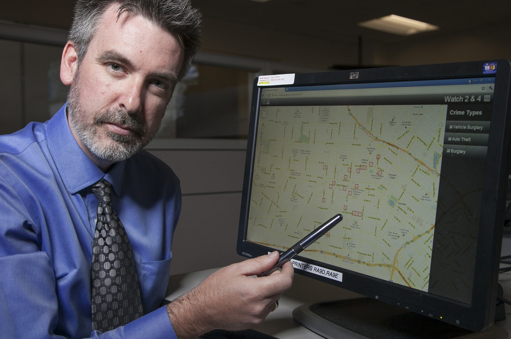 "Picture Published by  NPR   Jeff Brantingham, creator of PredPol, demonstrates computer-generated ""predictive policing"" zones at the Los Angeles Police Department Unified Command Post in Los Angeles last year."