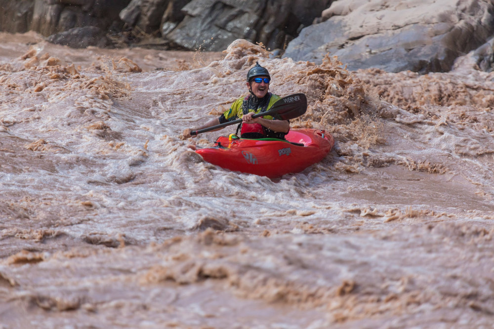 Blind kayaker Lonnie Bedwell having a blast in one of the Grand Canyon's rapids.