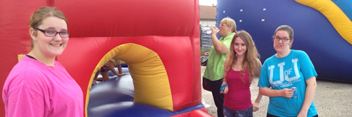 Teens-having-fun-with-bounce-house-at-Oxford-Assembly-of-God