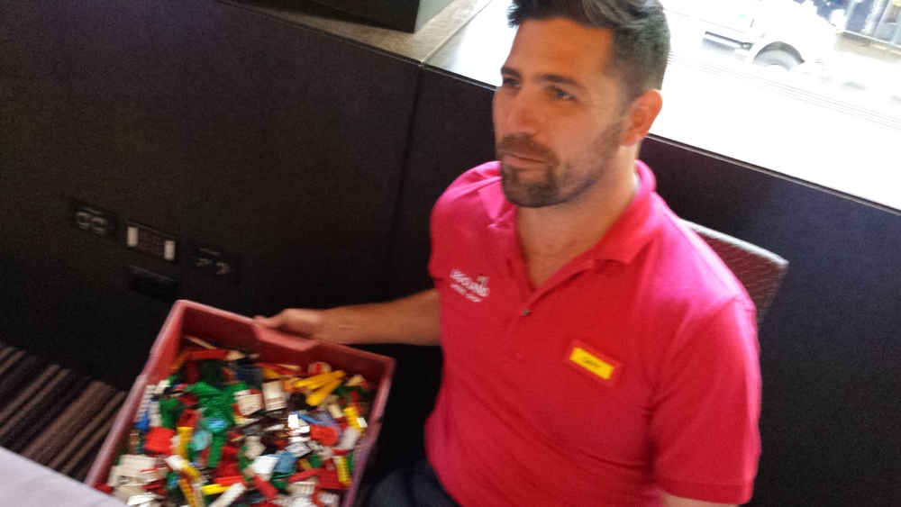 TOOLS OF THE TRADE:   MASTER MODEL BUILDER GARY MCINTYRE AND HIS CRATE OF RANDOM LEGO ELEMENTS.