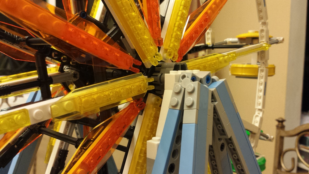 Trans-yellow and orange fins brighten up the wheel's spokes.