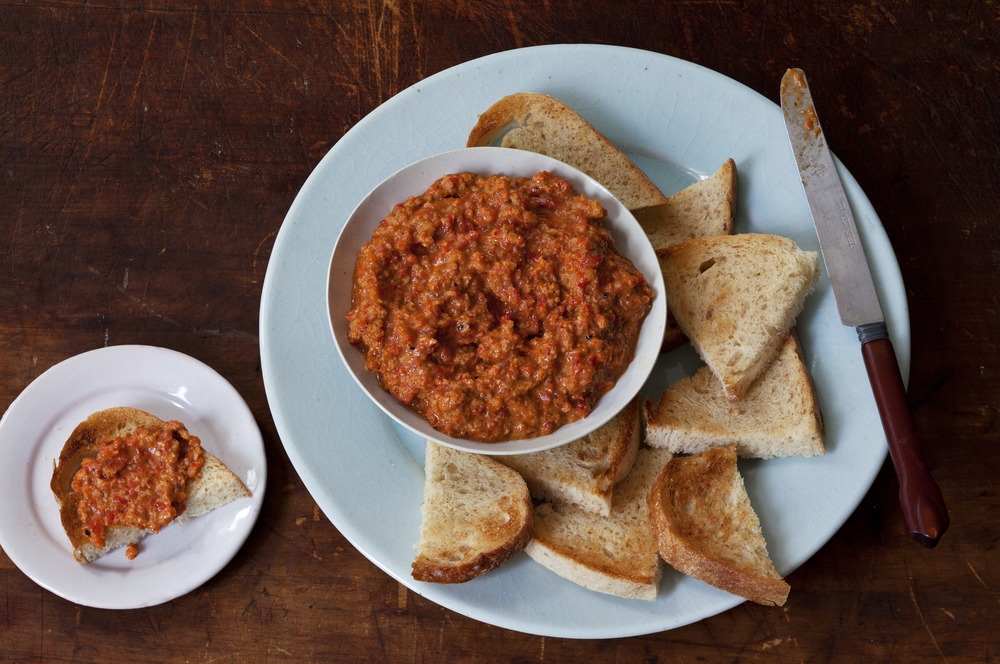 Muhammara  , a Lebanese spicy spread of roasted red peppers and walnuts
