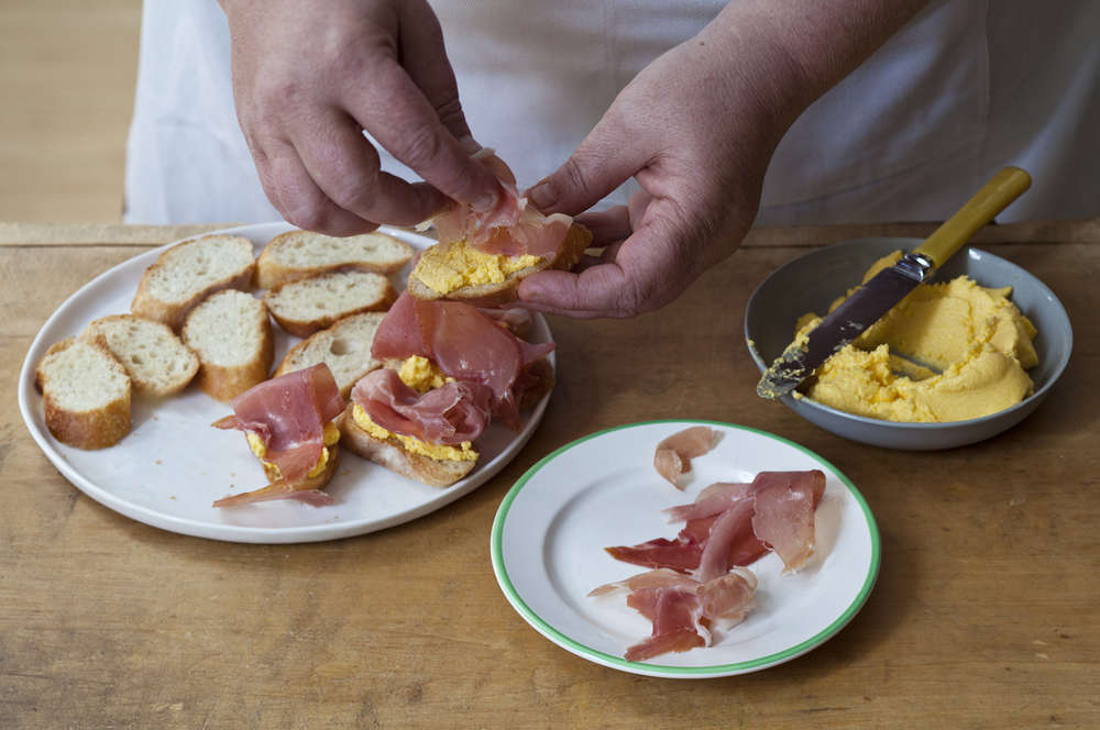 Prosciutto di Parma Crostini with Cantaloupe Butter