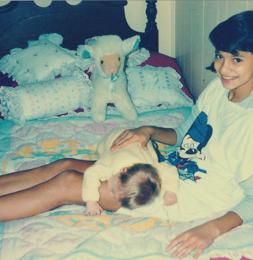Burping my baby sister, Dimi