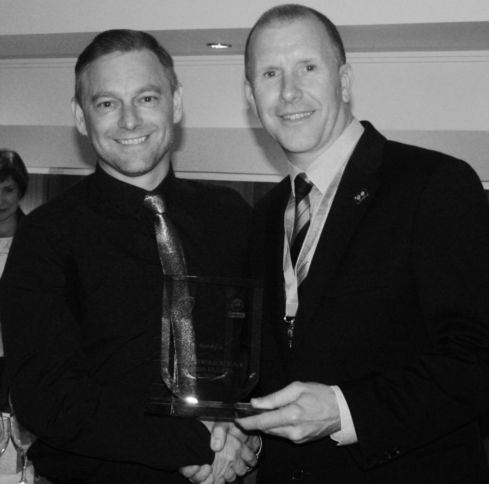 Eddie getting his award from Stewart Regan, SFA Chief