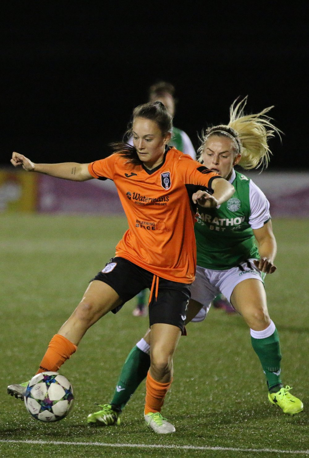 Citys Abbi Grant holds off Kirsty Smith of Hibs.JPG