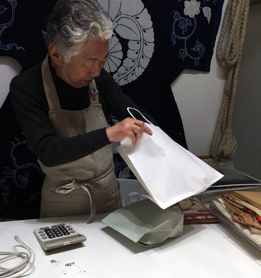 Owner, Tadashi Morita, packing my fabric purchases