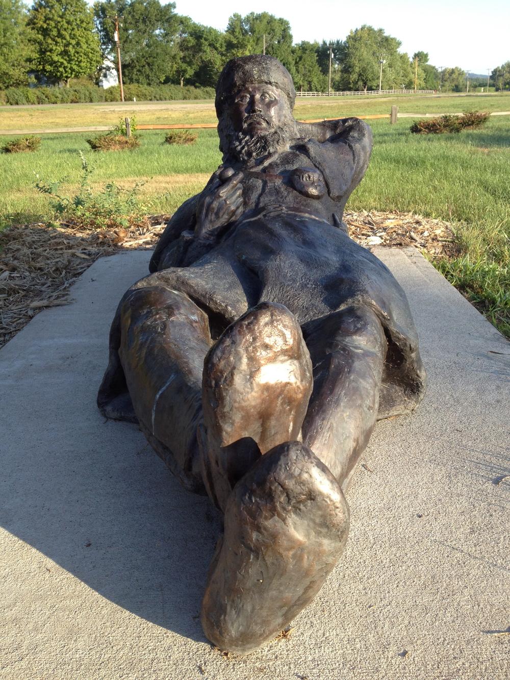 Lounging voyageur statue. Prairie Du Chien, WI