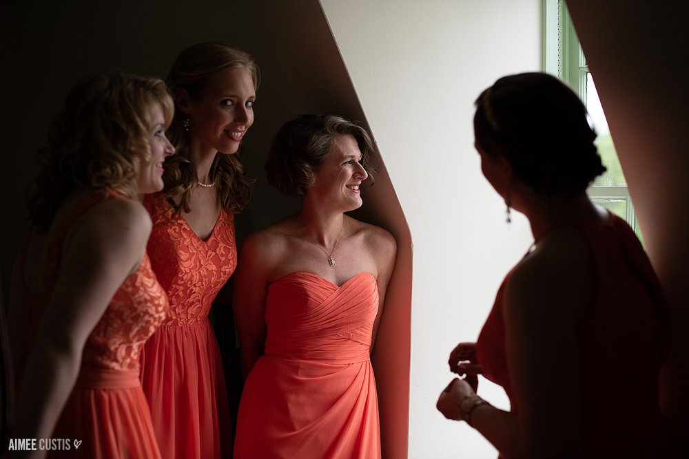 What's happening here? While I was off with the couple, orchestrating their first look on the balcony, these sneaky sneaky bridesmaids (and my second, Megan) were spying from the bridal suite window!!