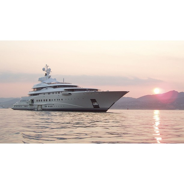 M/Y Pelorus.                         A dreamy sunset with Pelorus. 115 meters designed by Tim Heywood and built by Lurssen.#minimalist#beautiful#exotic#yacht#design#yachtclub#yachts#yachtdesign#luxuryyacht#luxury#yachtie#yachtcrew##superyacht#megayacht#sailing#boat#blue#yachtculture#aesthetic#proportion#contemporary#theyachtcollective#sealife#charter#pelorus#lurssen#terencedisdale#sunset