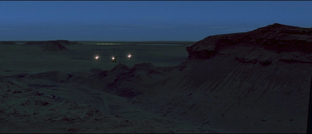 EXT. TATOOINE - DESERT MESA - NIGHT