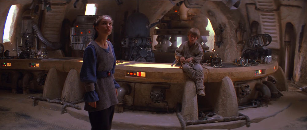INT. TATOOINE - MOS ESPA - WATTO'S SHOP - DAY