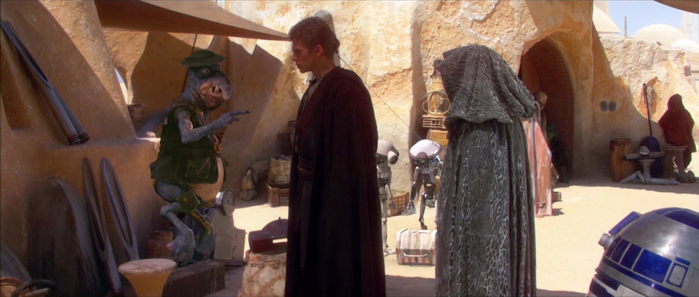 EXT. TATOOINE - MOS ESPA - WATTO'S SHOP - DAY