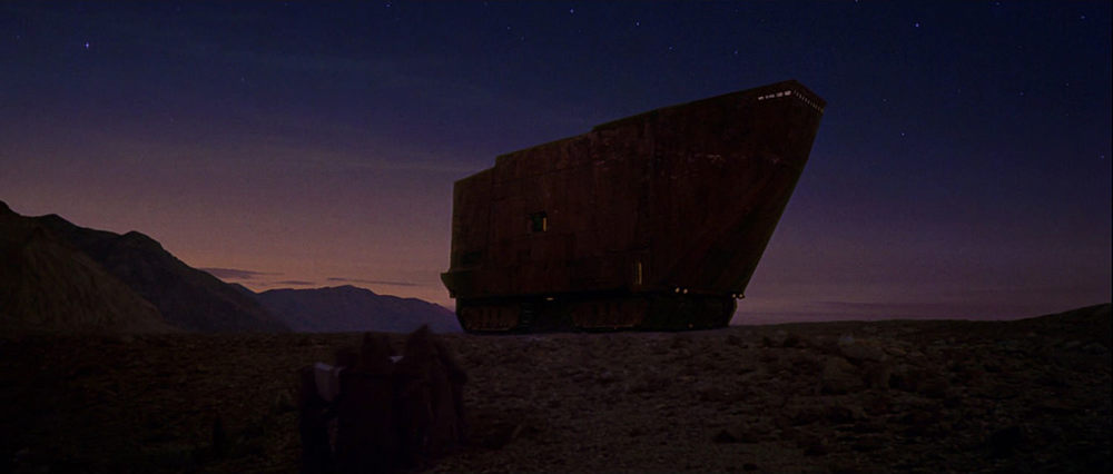 EXTERIOR: TATOOINE - ROCK CANYON - SANDCRAWLER - SUNSET