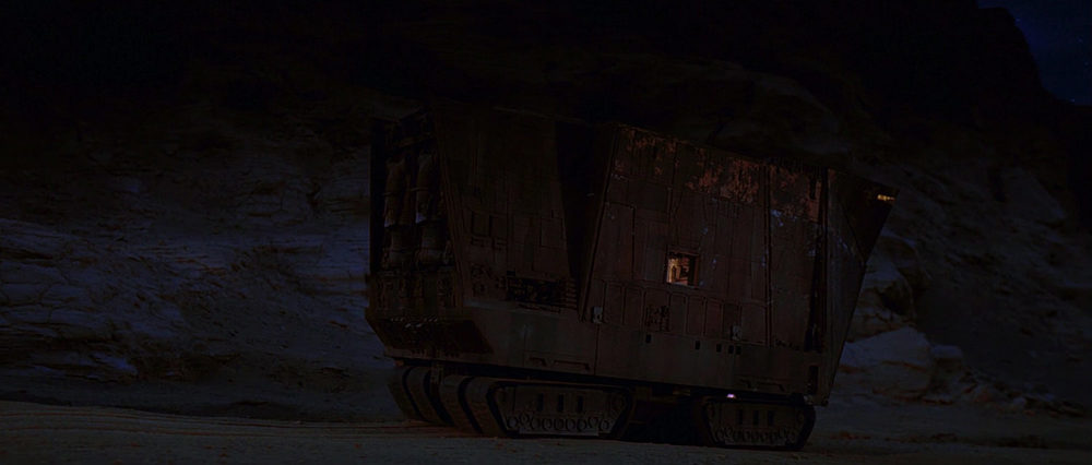 EXT. TATOOINE - ROCK CANYON - SANDCRAWLER - SUNSET