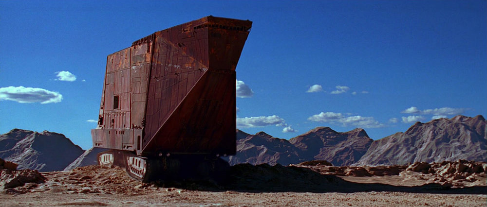 EXT. TATOOINE - LAR'S HOMESTEAD - SALT FLAT - AFTERNOON