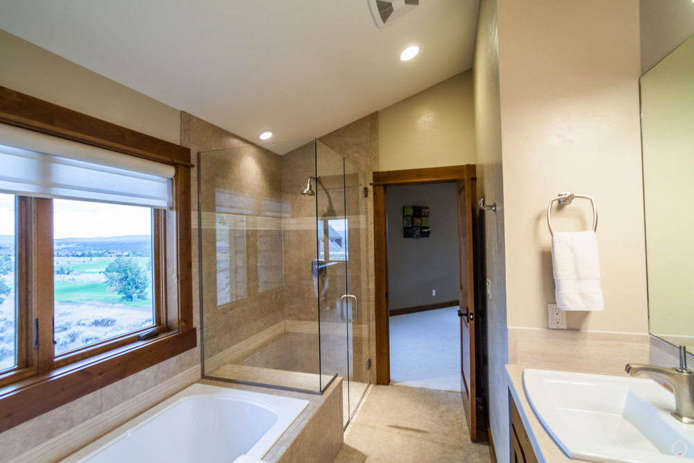 A frameless shower becomes part of the room.
