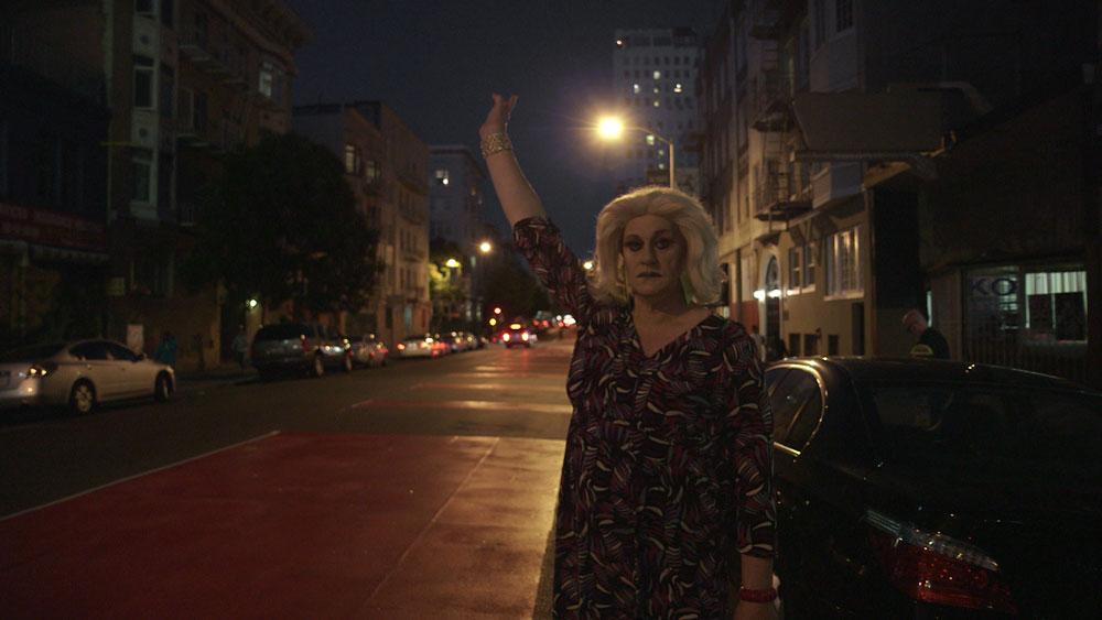 Collette LeGrande hails a cab.