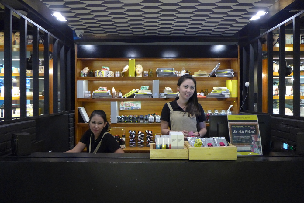 Friendly salesladies in the counter smiling for the camera