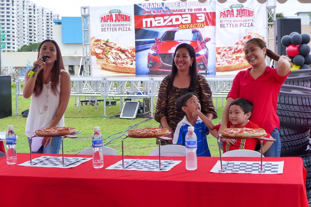 Pizza-eating contest participated by moms and their kiddos