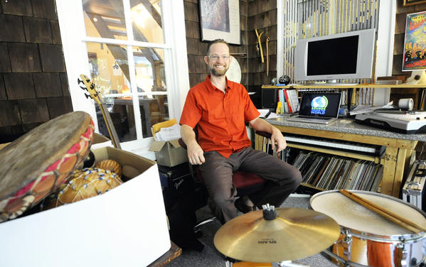 (   Staff photo by Jon Sham   / July 29, 2013 )   Jason Baker, a music therapist, sits at a desk in the back room of his Halethorpe home surrounded by musical instruments and computer equipment. Baker developed a game that uses international music to help students learn geography. He has taught at schools in Baltimore, Towson, Howard and Carroll counties.