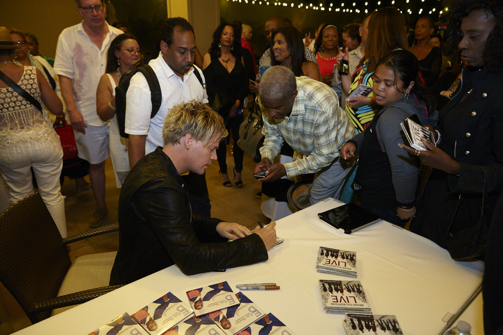 bc signing cd's at the after party last year. that guy on the top left has wine on his shirt...lol